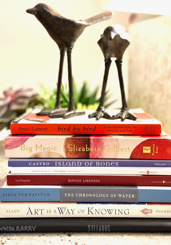 Stack of best writing books with Anne Lamott Bird by Bird, Big Magic by Elizabeth Gilbert, & Lynda Barry's Syllabus