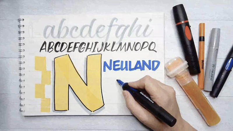 Neuland markers writing an N