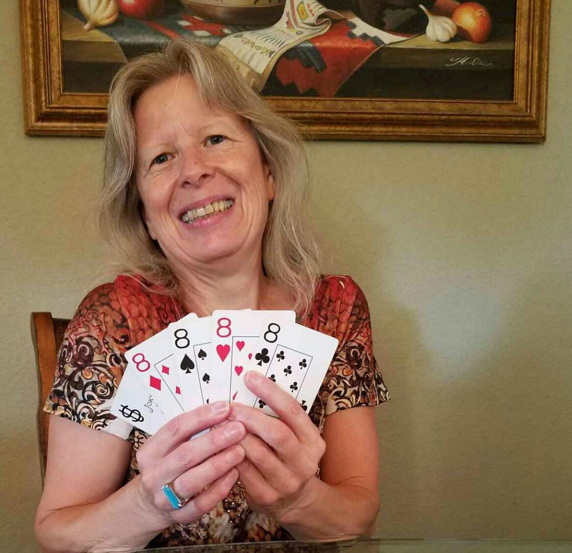 Milli Thornton with a hand full of lucky eights