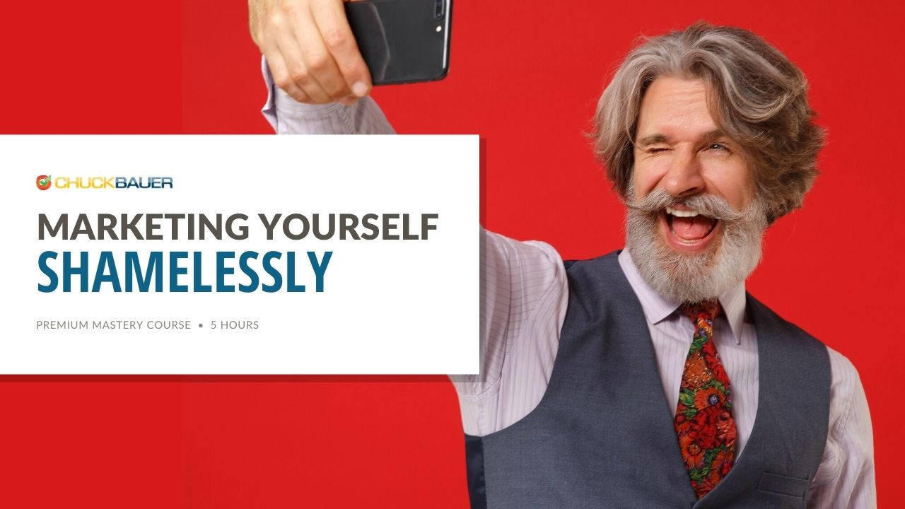Marketing Yourself Shameless - Premium Mastery Course - 5 Hours - A happy business owner is taking a selfie to market for his small business.