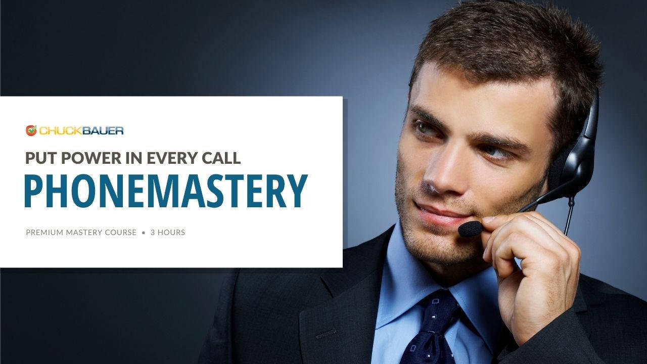 PhoneMastery - Premium Business Development Course - A highly successful businessman in a suit closes a sale over the telephone using a headset.