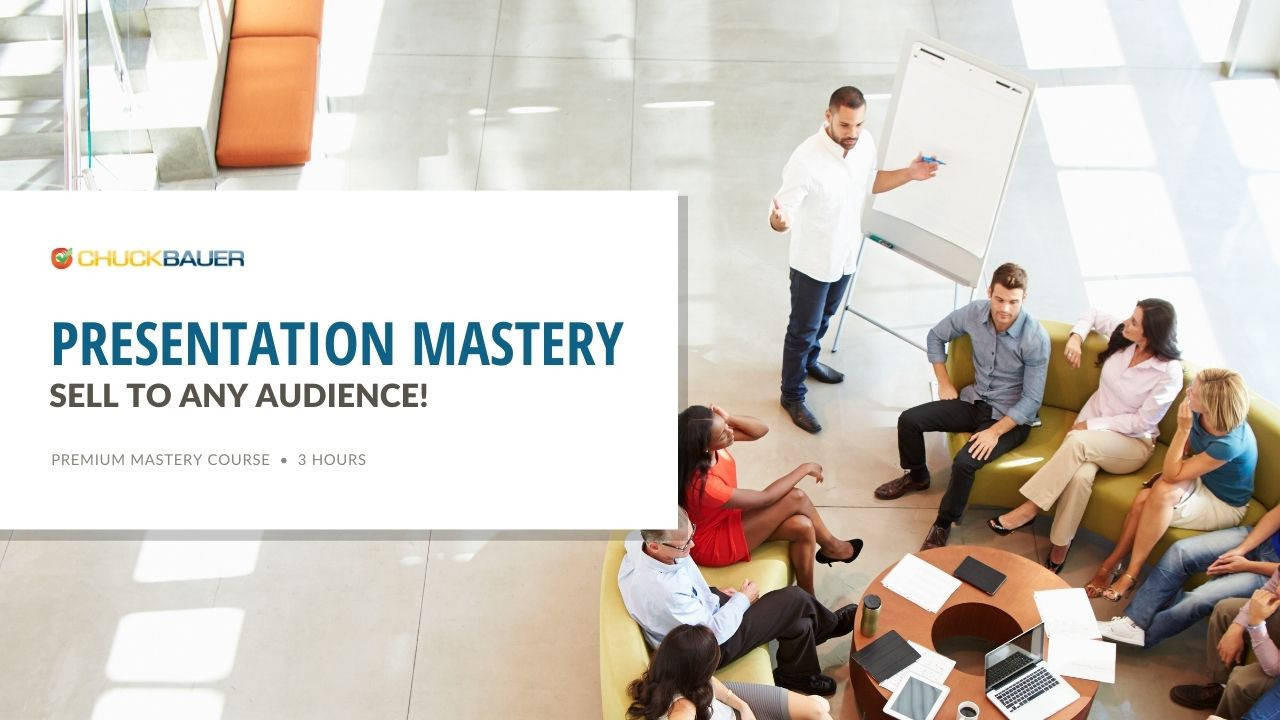 PresentationMastery - Premium Business Development Course - A business man gives a sales presentation to a group of industry peers.
