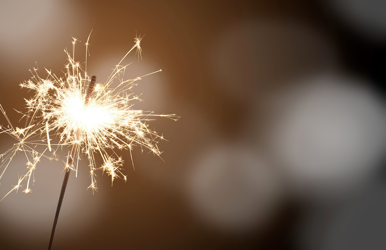 sparkler with bokeh lights in the background