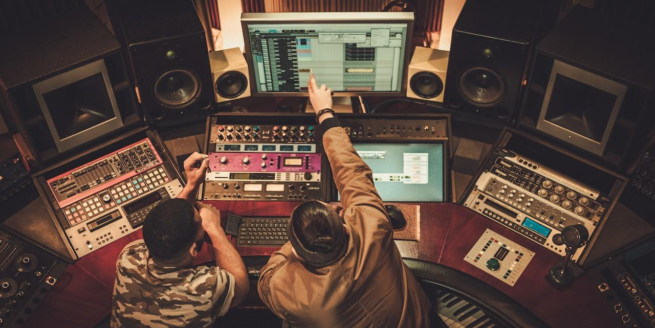 image of two men at recording console