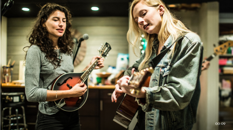 image of two women rehearsing music