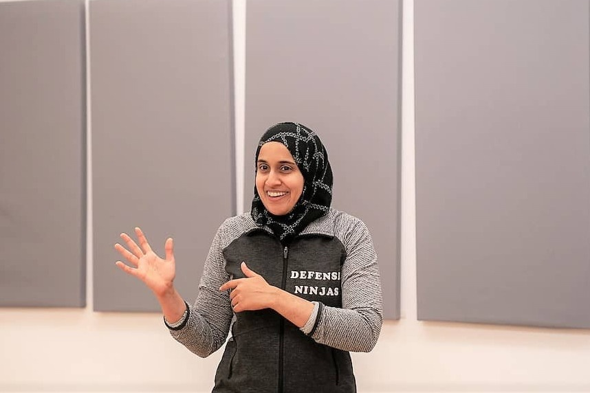 Fauzia Lala Women in STEM Personal Safety Coach wearing Defense Ninjas Jacket and Hijab at a Corporate Workshop
