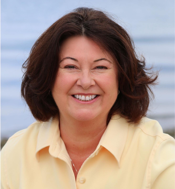 Maria Furlano headshot yellow shirt The Art Of Tuning In