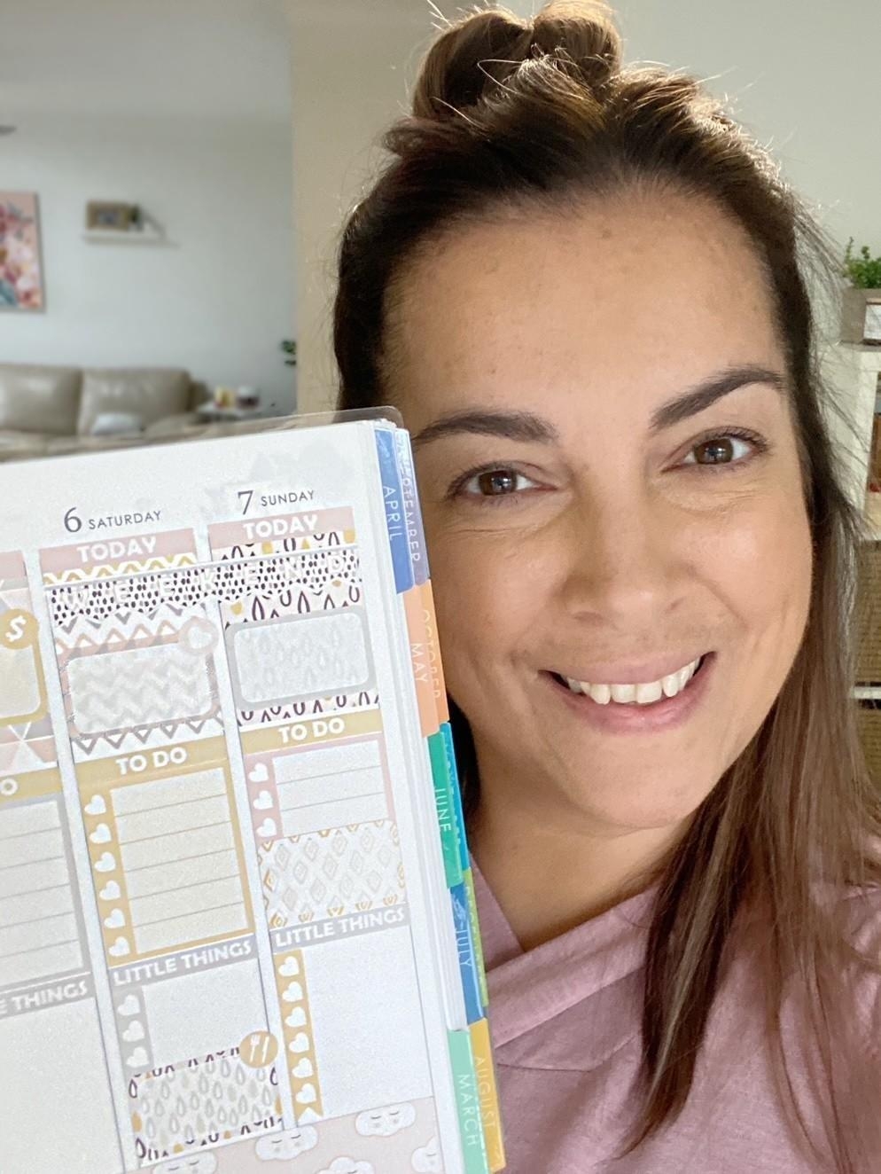 Woman holding planner