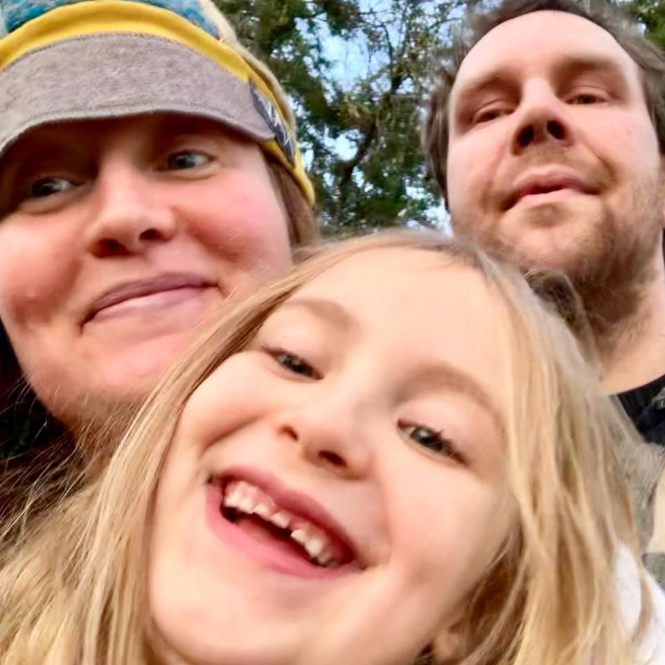 herbalist Melissa Mutterspaugh with her daughter and partner in the woods