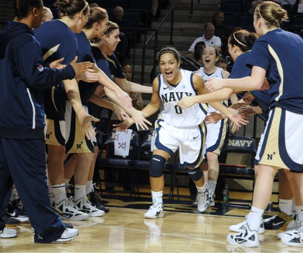 Basketball players celebrating a win