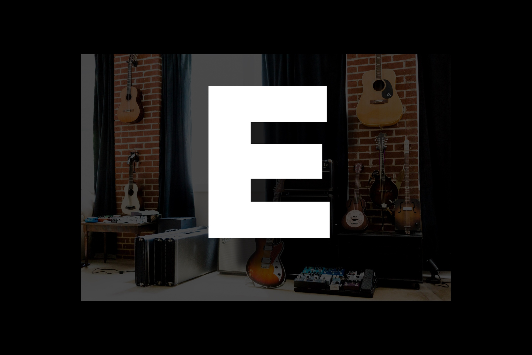 Glossary section containing music and guitar words that start with the letter E.