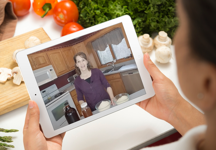 woman holding iPad in kitchen