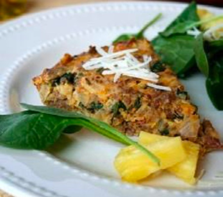 egg quiche on plate with spinach