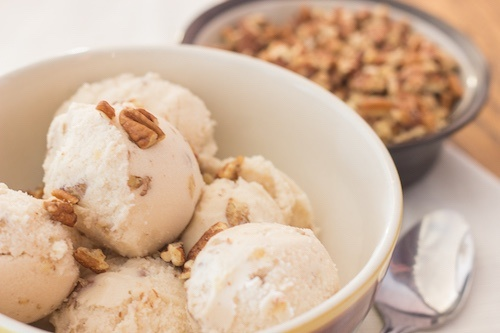 Butter Pecan candida ice cream in white bowl