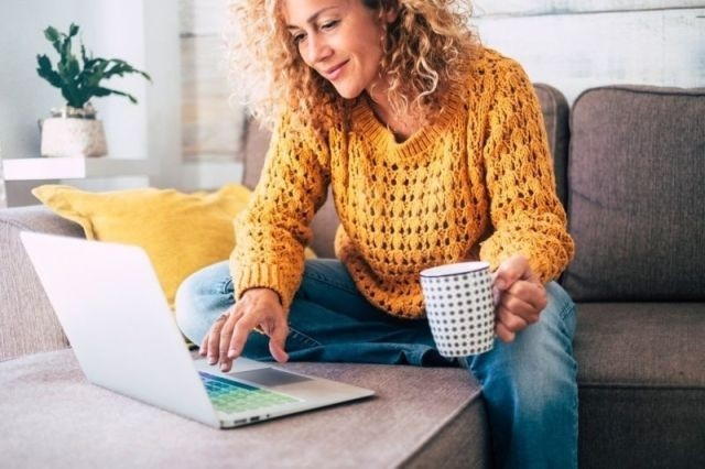 Menopause Experts Training Woman On Laptop