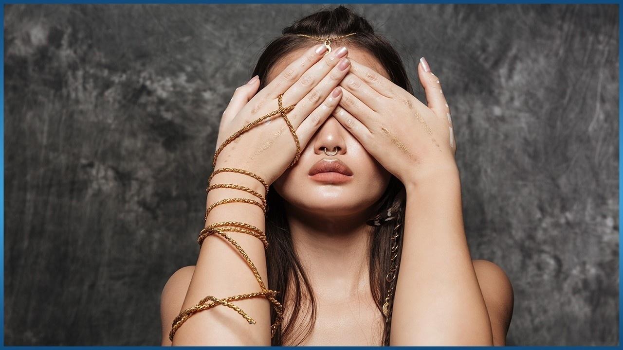 asian woman hiding her eyes