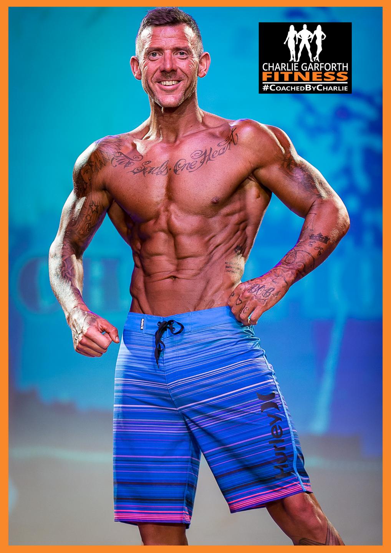 andre dcruz mens physique bodybuilder stage shot