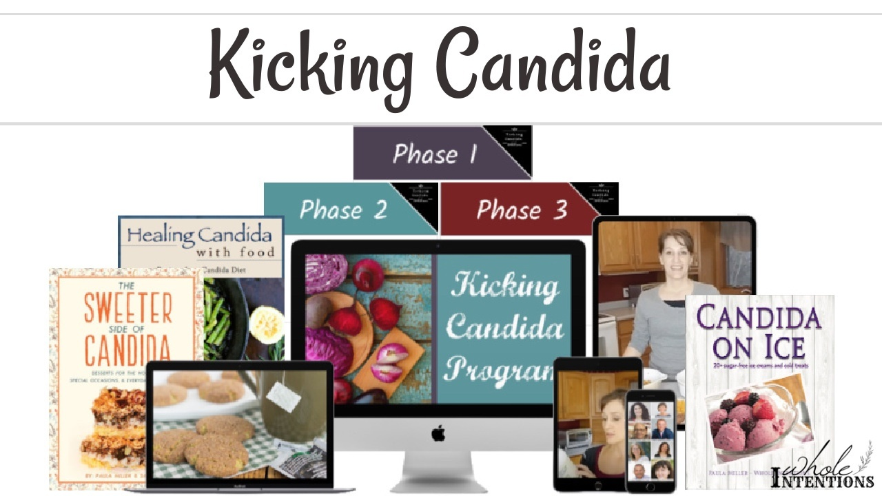 computer monitor displaying Kicking Candida Program surrounded by books and electronic devices