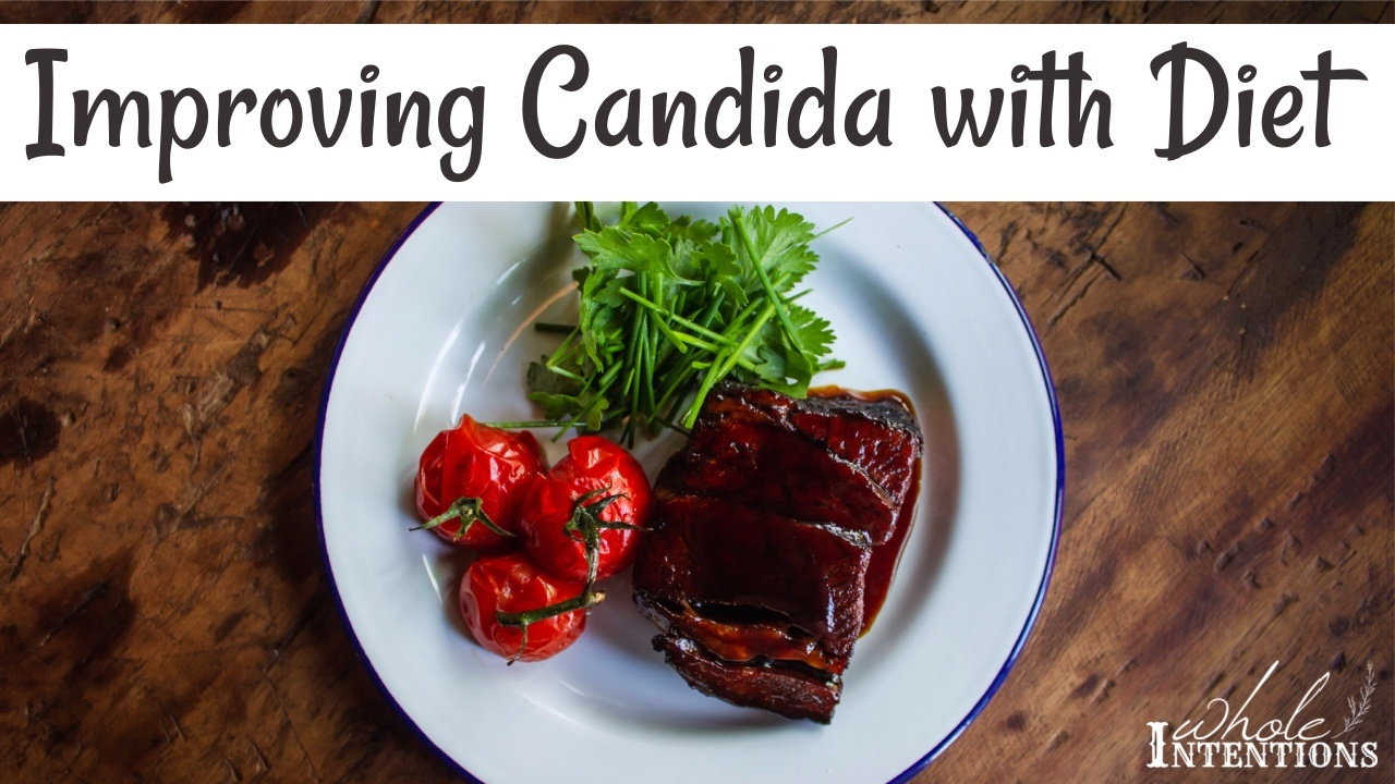 white plate with red tomatoes and green herbs for a candida diet