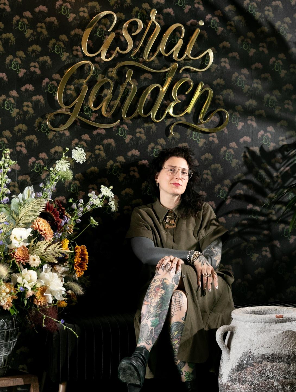 girl seating next to floral design Elizabeth Cronin Viva La Flora Live Podcast