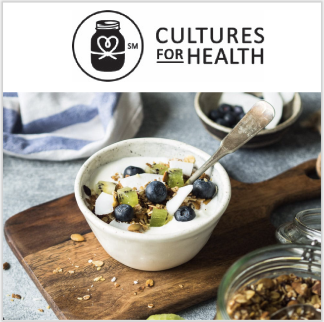 bowl of yogurt with blueberries on cutting board