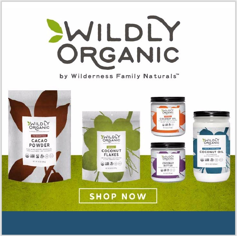 various bags of Wildly Organic whole foods on green background