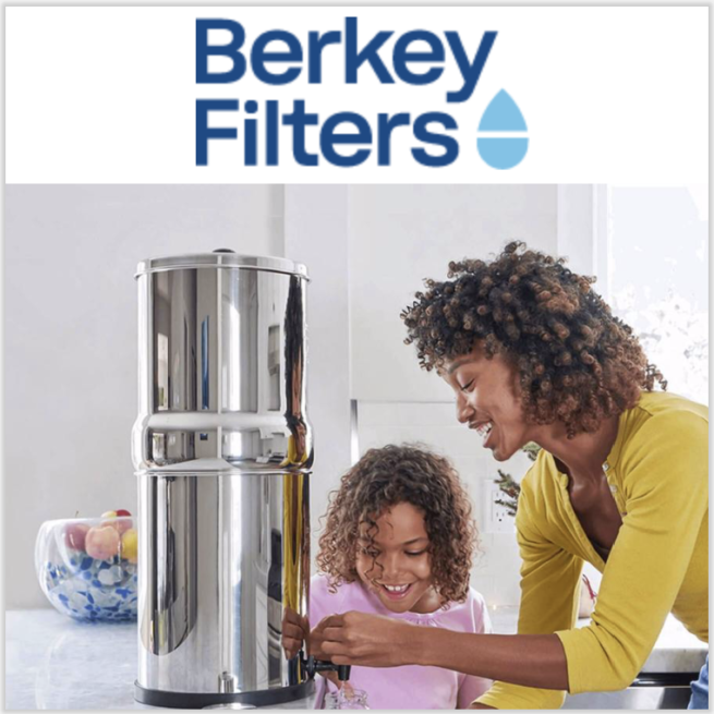 mother and daughter filling glass from Berkey Water Filtering system