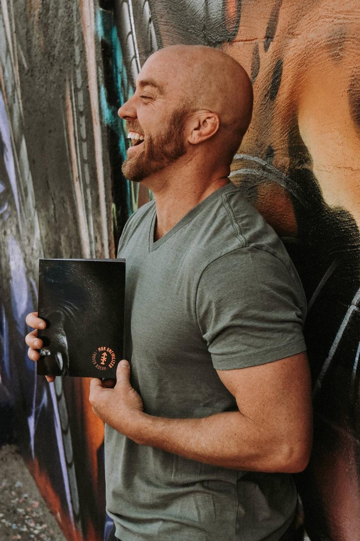 Traver Boehm holding the Man UNcivilized book