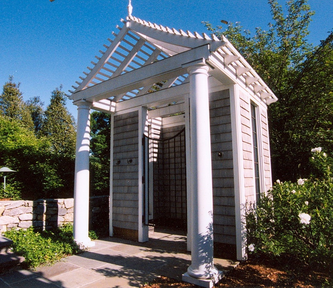Pool house shower enclosure with swaled roof