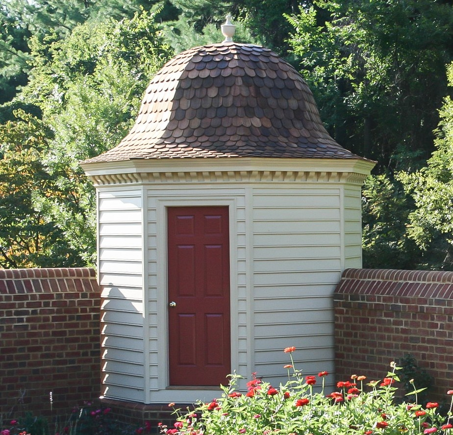 Mt Vernon privy reproduction outbuilding used as a garden shed