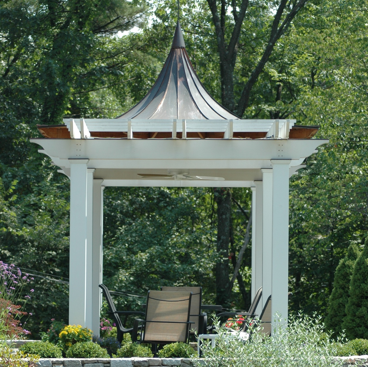 Pergola pavilion with a  standing seam Copper roof, with curved roof lines